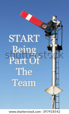 Historic red home British railway signal in the start position with an Inspirational motivational quote of Start Being Part Of The Team against a clear blue sky  - stock photo
