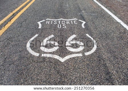 Historic Route 66 sign painted on the Mother Road in Arizona - stock photo