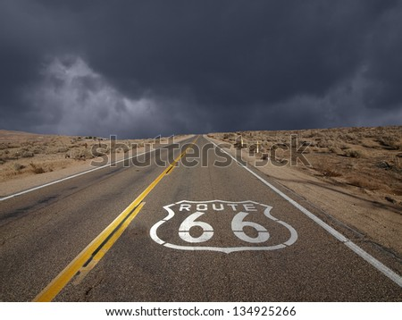 Historic Route 66 storm sky in California's Mojave desert. - stock photo