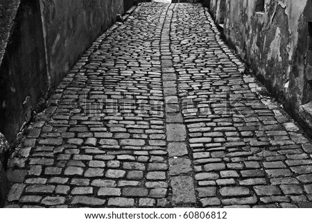 historic small street in the old town, black and white - stock photo