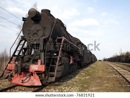 Historic steam train on an abandoned branch line - stock photo