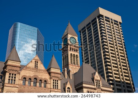 Historic Toronto city hall with modern skyscrapers behind - stock photo