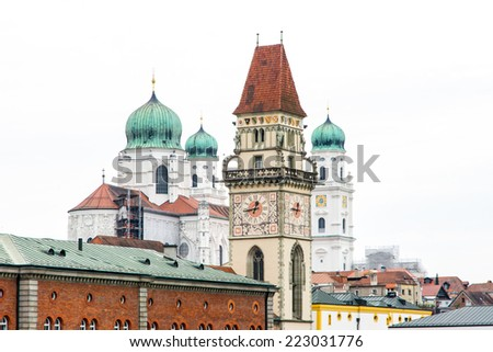 Historic towers of Passau - the old town hall and Saint Stephen's cathedral - stock photo