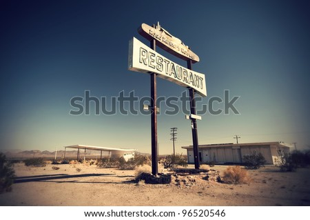 Historic vintage restaurant and gas station sign on old Route 66 in the desert, California, USA Historisches altes Restaurant und Tankstellen Schild an der Route 66 in der Wüste,  Kalifornien, USA - stock photo