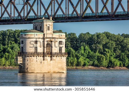 Historic water intake tower number 2 built in 1915 and the Old Chain of Rocks bridge on the Mississippi River near St Louis - stock photo