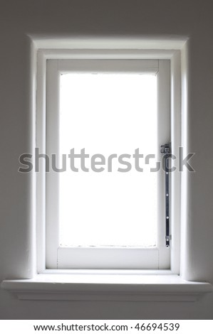 historic white window with sun light and metal handle - stock photo