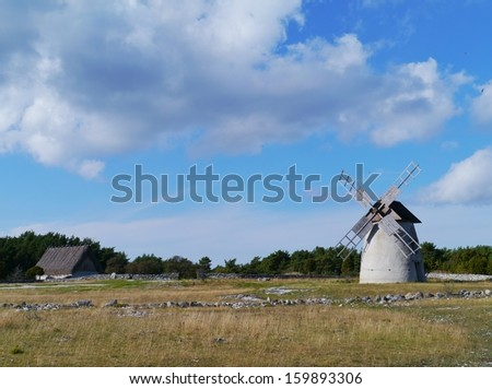 Historic wind mill on the Swedish island faroe in the Baltic sea of Sweden - stock photo