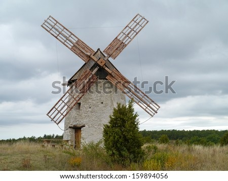 Historic wind mill on the Swedish island Gotland in the Baltic sea of Sweden - stock photo