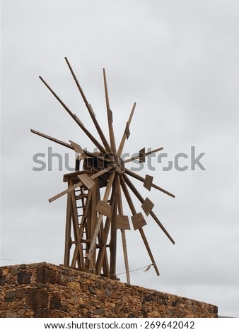 Historic wooden wind mill in Valles de Ortega with twelve wings on the Spanish island Fuerteventura one of the Canary islands in the Atlantic Ocean belonging to Spain - stock photo