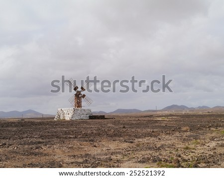 Historic wooden wind mill near the village Puerto Lajas on the Spanish island Fuerteventura one of the Canary islands in the Atlantic Ocean - stock photo