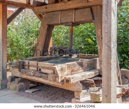 historic wooden winepress seen in Riquewihr, a town in Alsace, France - stock photo