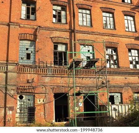 Historical abandoned red building, Peterburg, Russia. - stock photo