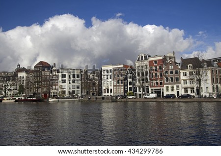 Historical buildings along a canal in Amsterdam, Holland - stock photo