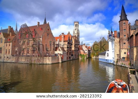 Historical buildings and distant Belfry in the old town of Bruges, Belgium
