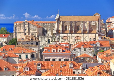 Historical buildings and distant church above the Adriatic sea, Dubrovnik, Croatia - stock photo