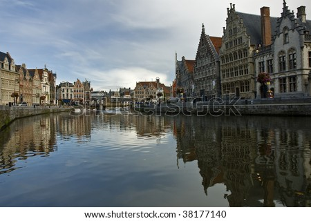 Historical buildings of the beautiful Belgian town Ghent reflecting in water - stock photo