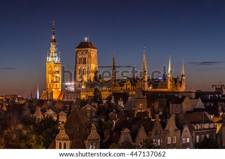 Historical center of Gdansk, town hall and St. Mary's Church illuminated at night - stock photo