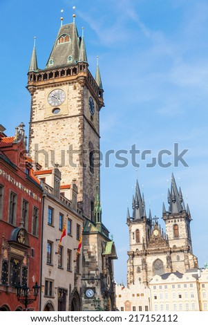 historical City Hall Tower with the famous astromical clock and Church of Our Lady before Tyn at the Old Town Square in Prague, Czechia - stock photo