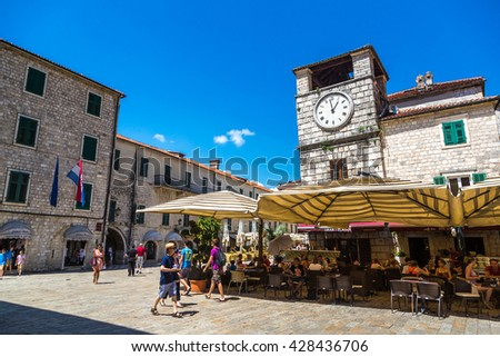 HISTORICAL CITY OF KOTOR, MONTENEGRO - AUGUST 4th 2014: Tourists and locals walk in the historical city of Kotor in Montenegro.