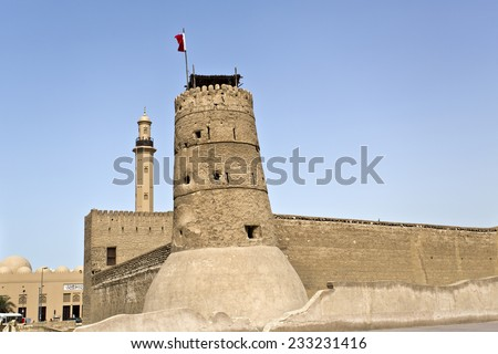 Historical Dubai Museum in Dubai with the minaret of the Grand Mosque in the background, United Arab Emirates - stock photo