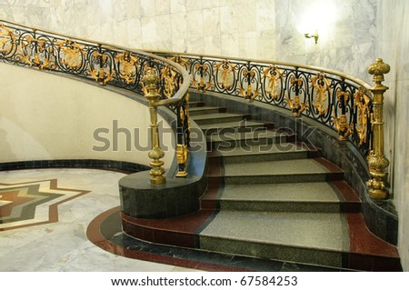 Historical entrance hall with vintage staircase / Spiral staircase - stock photo