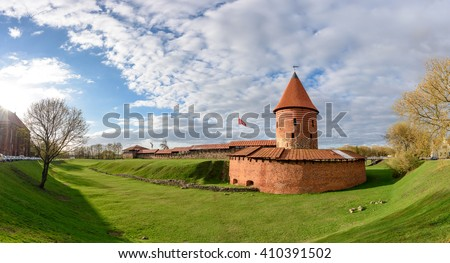 Historical gothic Kaunas Castle from medieval times in Kaunas, Lithuania. Wide angle panoramic view on cloudy sky background. - stock photo