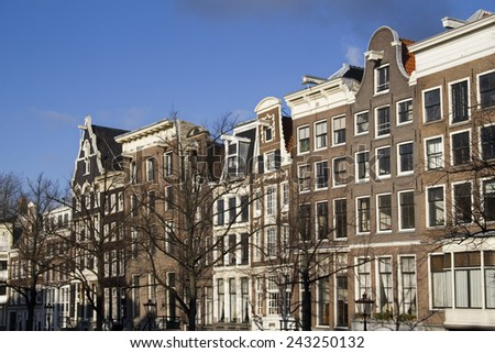 Historical houses on a sunny winter day in the old part of Amsterdam, Holland - stock photo