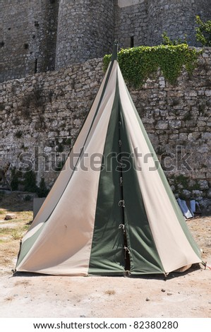 Historical medieval camp tent green and white - stock photo