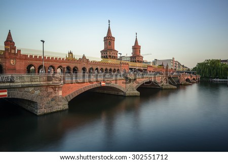 historical Oberbaum bridge (Oberbaumbruecke) and the river Spree in Berlin, Germany, Europe - stock photo