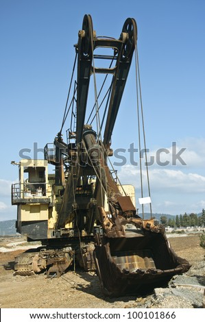 Historical old mining big machines backhoe - bulldozer working in old development, Riotinto