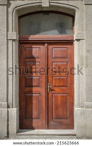 Historical Ornate Wooden Door in a Stone Entry with Arc, Prague, The Czech Republic - stock photo
