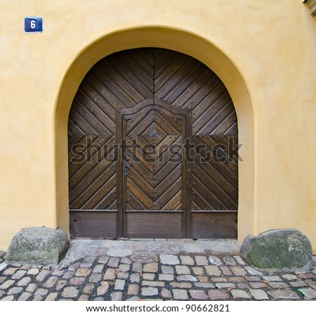 Historical Ornate Wooden Door with 2 Stones, Prague, The Czech Republic - stock photo
