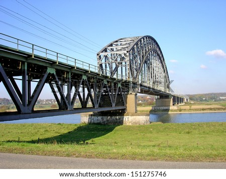 Historical railway bridge crossing the river Rhine at Oosterbeek, the Netherlands. Famous for its part at the battle of Arnhem during the second World War - stock photo