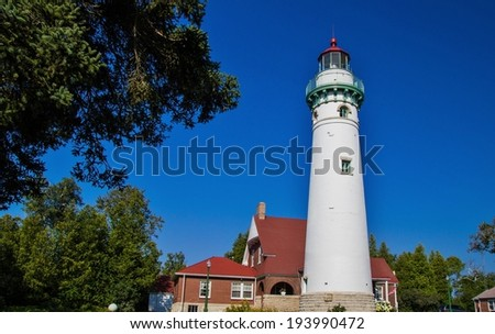 Historical Seul Choix Point Lighthouse is an active light along the Great Lakes shoreline in Michigan s Upper Peninsula .  - stock photo