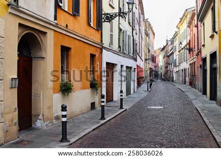 Historical street in Italian city, Parma, Italy - stock photo