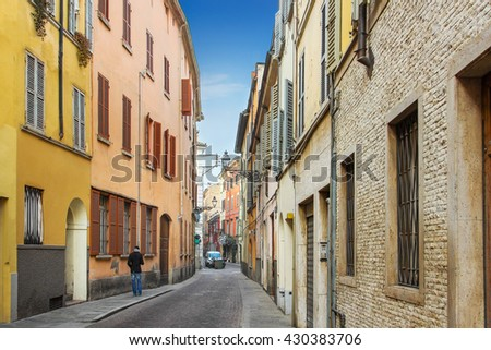 Historical street with many residential houses in Parma, Emilia-Romagna region, Italy. - stock photo