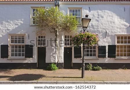 Historical white-washed facades in Utrecht, the Netherlands. - stock photo