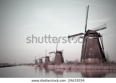 Historical windmill park near a canal. - stock photo