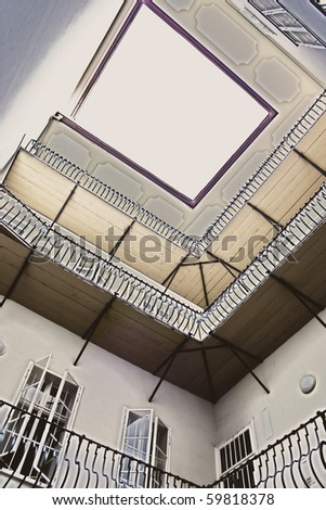 Historical yard with balcony and beautiful slab - stock photo