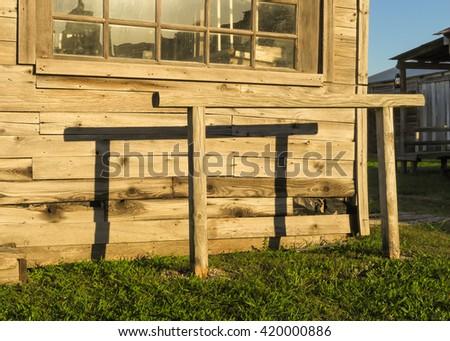 hitching post near sunset - stock photo