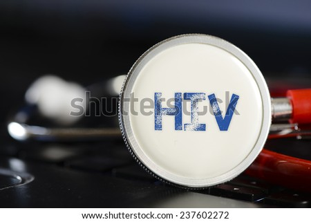HIV sign and stethoscope. HIV sign and stethoscope. Medicine concept on computer keyboards - stock photo