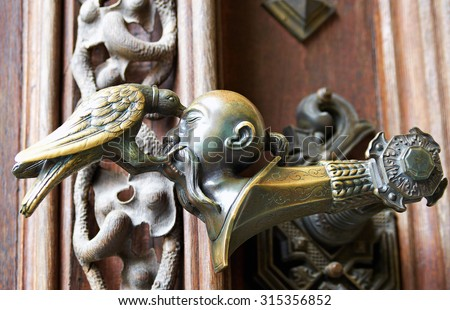 Hluboka nad Vltavou, Czech Republic, September 26 2014. Door handle at the entrance in Hluboka nad Vltavou castle, arms of House of Schwarzenberg