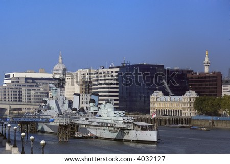 HMS Belfast  moored on the Thames between Tower and London Bridge - stock photo