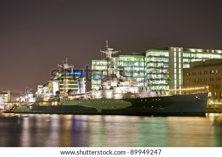 HMS Belfast warship docked on Thames river at London, England - stock photo