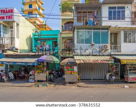 HO CHI MINH CITY - JAN 31: Street view of Ho Chi Minh City in Vietnam on January 31, 2015. Ho Chi Minh City, formerly named Saigon is the largest city in Vietnam. - stock photo