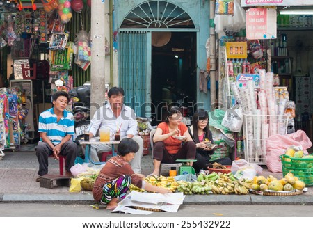 Ho Chi Minh City-Nov 1st 2013: Street vendors waiting for customers. Vendors can be found all over the city. - stock photo
