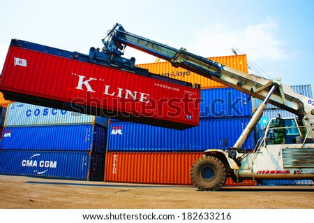 HO CHI MINH CITY, VIET NAM- MAR 19 :  Forklift truck crane container at  freight depot, cargo box in stack, this industrial port is logistic service of import, export  goods ,Vietnam, Mar 19, 2014 - stock photo