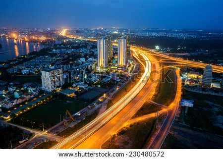 HO CHI MINH CITY, VIET NAM on 14 NOV 2014: Panoramic view of National Route 1A in  Ho Chi Minh city (or Saigon) in twilight, Vietnam. - stock photo