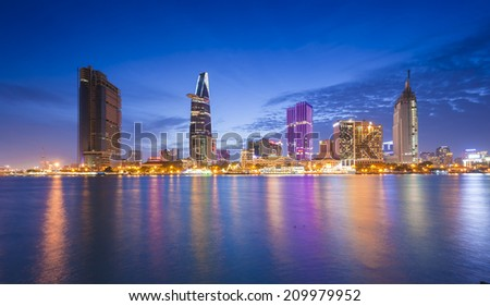 HO CHI MINH CITY, VIETNAM - Aug 2: Night view of Business and Administrative Center of Ho Chi Minh city on Saigon riverbank on Aug 2, 2014 - stock photo
