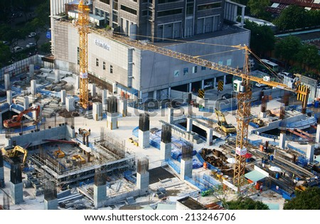HO CHI MINH CITY, VIETNAM- AUG 21: Panaroma of construction work at Asia city, steel rod rise up from concrete pillar, development of real estate make increase construct industry, Vietnam, Aug 9, 2014 - stock photo
